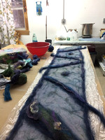 Nuno felting- laying out the wool and decor onto the silk background